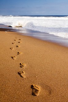 Energy Healing. Library Image: Footsteps in Sand